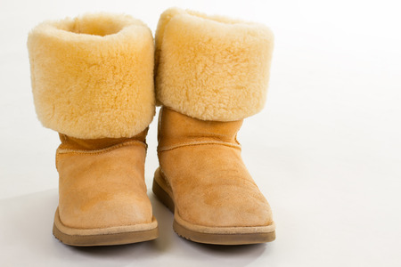 Funny yellow winter Australian boots. Winter boots with natural sheepskin. Stock Photo