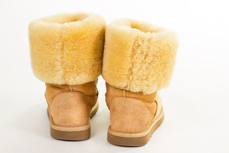 Warm suede boots with sheep wool. Stylish womens boots for winter. Stock Photo