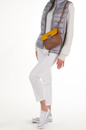 Gray vest and a purse. Stylish young woman. Girl wearing casual outfit. Spring outfit and brown purse.