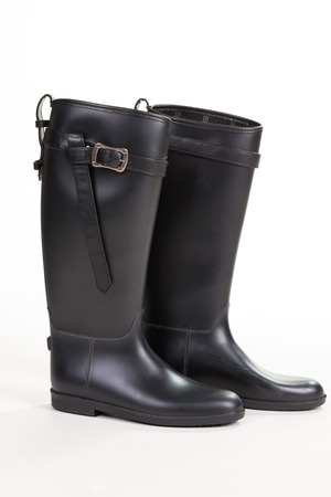 Fashionable modern rubber boots. Shoes for rainy weather.