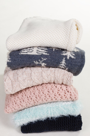 Stack Of Beautiful Handmade Sweaters With Different Patterns