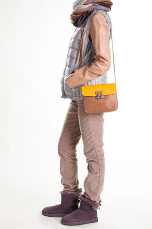 Womans casual spring apparel. Woolen scarf and bicolor purse. Casual outerwear with leather purse. Reasonable spring outfit. Stock Photo