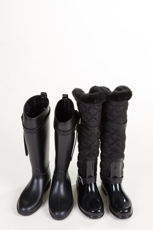 Two pairs of stylish rubber boots. Youth womens shoes for autumn.Youth womens shoes for autumn. Black rubber boots.