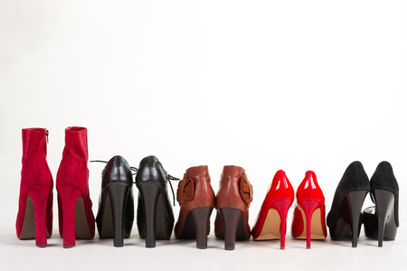 Beautiful new womens shoes lined up in a row. High-heeled shoes.