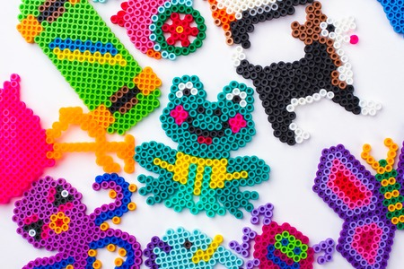 Easy perled bead animals. Gather of animals, flat lay, top view.