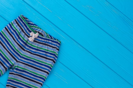 Striped cotton pants. Blue wood background. Stockfoto