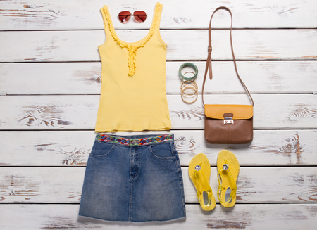 Light summer outfit. Bright summer clothing and accessories.