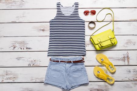 Summer collection of womenswear. Sailor suit, blue shorts and accessories.