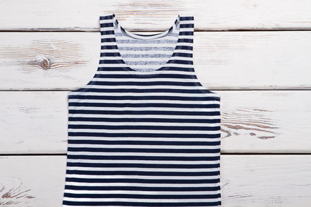 Sailor suit on a wooden background. Summer womens tank top.
