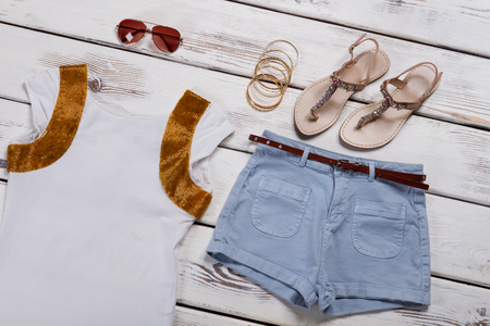 Beautiful summer outfit. Summer collection of clothes and accessories. Womens clothes set. Imagens