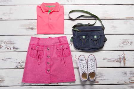 Clothing of the young girl teenager. Bright informal clothes.