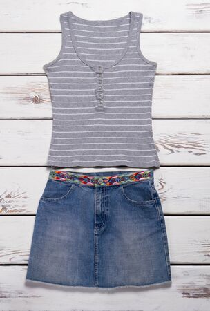 Jeans skirt and tank top. Striped gray top with skirt. Female clothes on store showcase. New items in stock. Zdjęcie Seryjne
