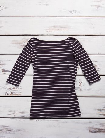 Black and white striped top. Casual top with long sleeves. Female garment in outlet shop. Good quality at fair price.