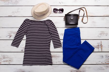 Striped top and blue pants. Navy trousers and beige hat. Ladys regular fit pants. Low prices in shopping mall. Zdjęcie Seryjne