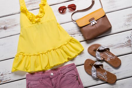 Bright summer clothes. Seasonal sales in the show room. Zdjęcie Seryjne