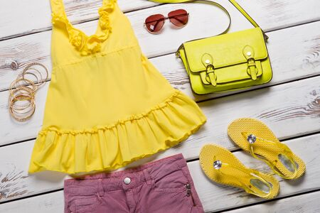 Bright stylish womens clothing. Summer wardrobe for a young girl.