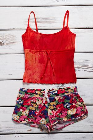 Beachwear for a young girl. Bright multi-colored summer shirt and shorts. Zdjęcie Seryjne
