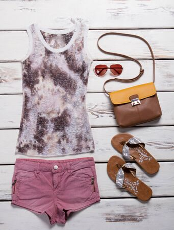 Summer beach wear for a young girl. Summer collection of clothes and accessories.