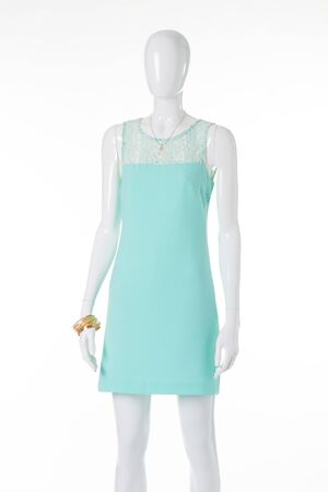 Delicate lace turquoise dress. Summer dress with gold accessories. Stock Photo