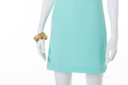 Beautiful turquoise dress with gold bracelets. Summer sales. Stock Photo