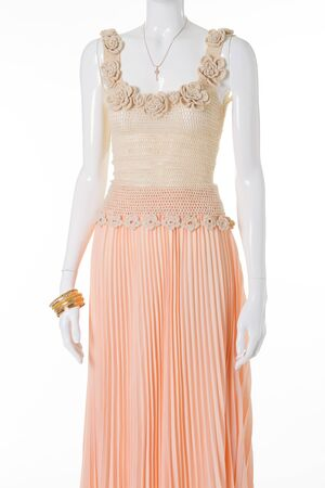 Beautiful gentle ladys outfit. Knitted handmade top and peach pleated skirt.