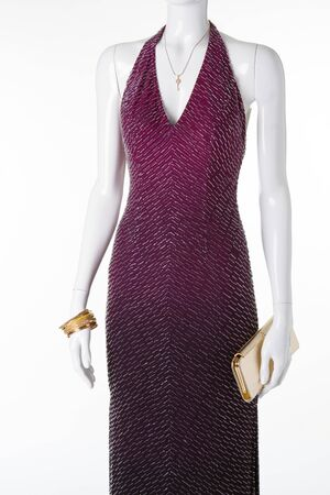 An elegant evening dress on a white mannequin. Store sales and rentals of evening dresses.