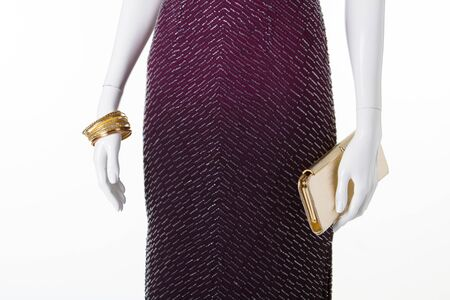 Beautiful detail of evening dress. Elegant dress with gold accessories.
