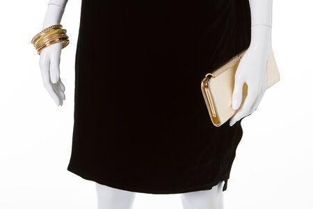 Black dress on white mannequin. Clothes and accessories. Reklamní fotografie