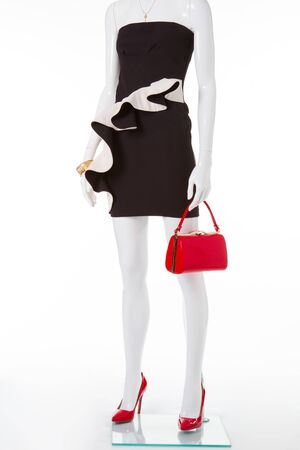 Evening white-black dress with abasque. Cocktail dress with red shoes and bag.
