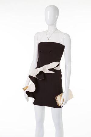 Fashion black dress with white basque. Cocktail dress with gold clutch.