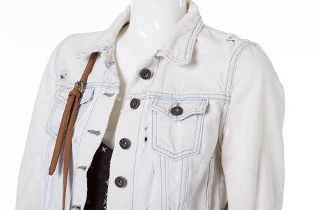 Fashionable denim jacket on a white mannequin. Stylish ragged white denim jacket.