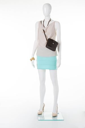 Beautiful elegant womens clothing on a mannequin. Mannequin for womens clothing boutique. Stock Photo
