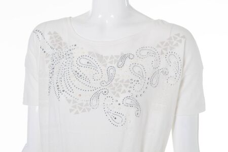 Blouse with rhinestone. White blouse on mannequin. Girls white clothing for summer. Lightness and style.