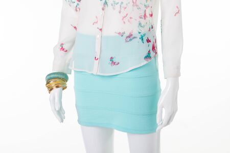Beautiful turquoise tight-fitting skirt and chiffon blouse. Gentle summer clothing. Stock Photo