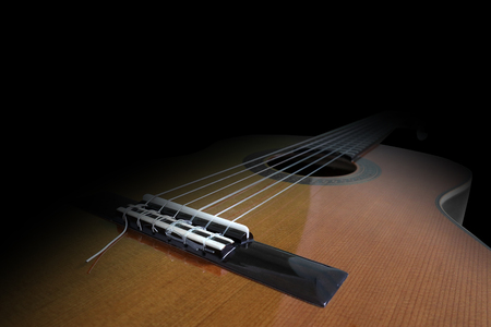 lying guitar in front of black background