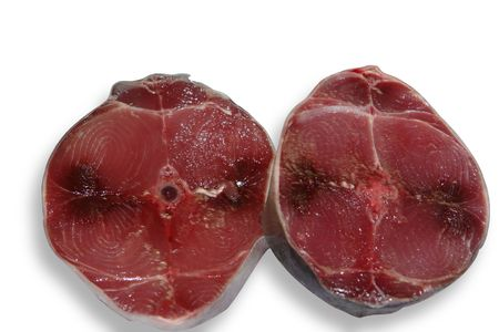isolees: blue fin fish tuna slices some, two blue fin tuna sections isolees on white zone,