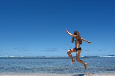 finally: tropical moment of freedom on beach, woman who jumps on a beach and bottom tropical lagoon,
