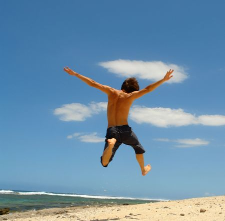 jump on the beach, symbolizes freedom, the joy and happiness,