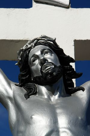 divine suffering, portrait of jesus on the cross  photo