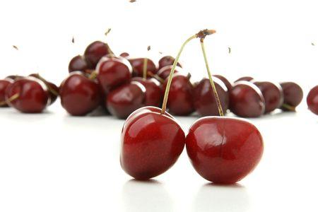 Fresh and beautiful cherries, isolated on white background photo