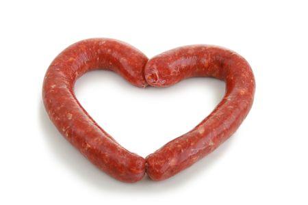 Heart-shaped sausage isolated on white background photo