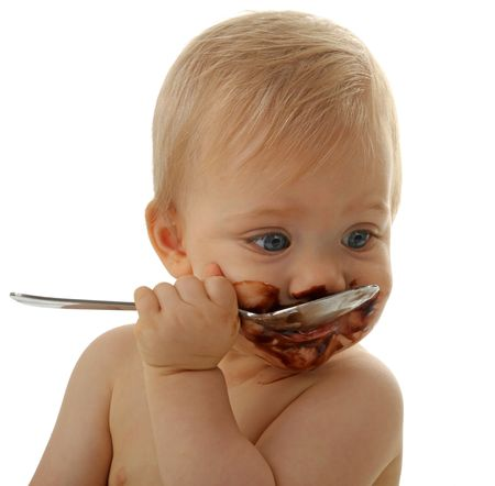baby with spoon: baby eating chocolate