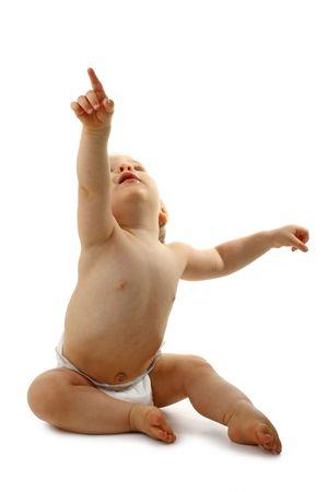 amazed: baby sitting pointing up