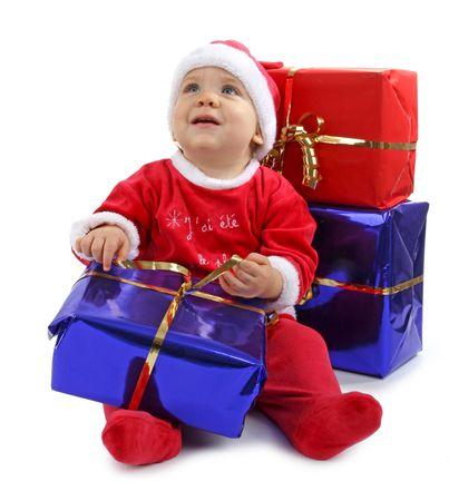 christmas baby wih gifts photo