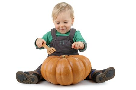 baby play with pumpkin photo