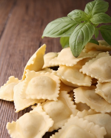 ravioli: ravioli and basil Stock Photo