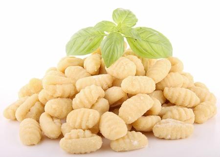 gnocchi: isolated uncooked gnocchi on white background
