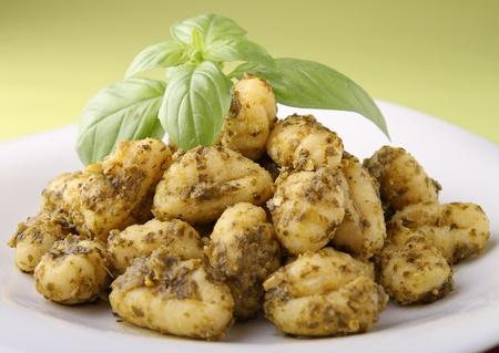 gnocchi with pesto sauce photo