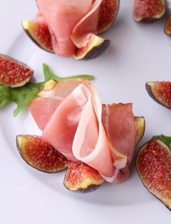 gastronomy: appetizer, fresh figs with prosciutto ham