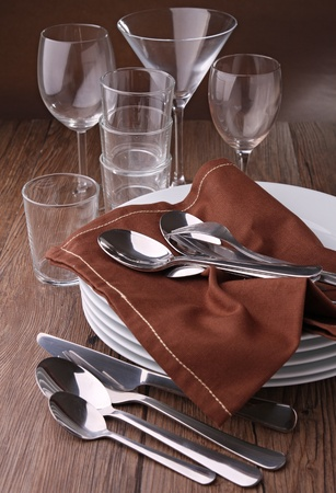 plates with cutlery and glasses photo
